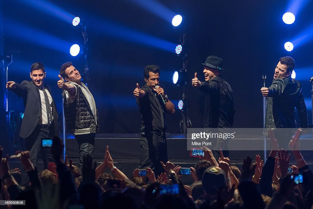 Jonathan Knight, Joey McIntyre, Danny Wood, Jordan Knight, and Donnie Wahlberg of the New Kids On The Block perform at the Gramercy Theatre on February 15, 2015 in New York City.