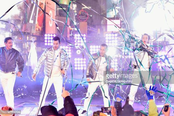 Jonathan Knight Jordan Knight Danny Wood and Joey McIntyre of New Kids on the Block perform on stage during Dick Clark's New Year's Rockin' Eve With...