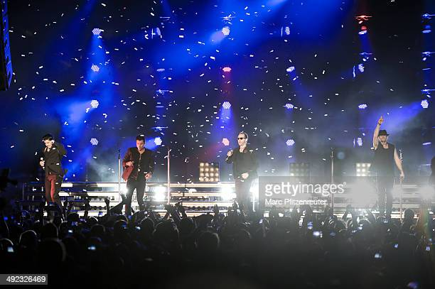Jonathan Knight Jordan Knight Donnie Wahlberg and Joey McIntyre of American Boygroup New Kids On The Block perform during their 'Let's get Intimate...