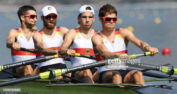 Jonathan Koch, Lars Wichert, Tobias Franzmann, Lucas Schaefer of Germany compete in the Lightweight Men's Four Semifinals of the Rowing events during...