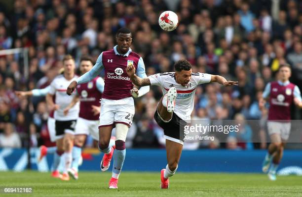 Jonathan Kodija of Aston Villa tackles Ryan Fredericks of Fulham in the build up to the red card of Jonathan Kodija of Aston Villa during the Sky Bet...