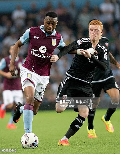 Jonathan Kodjia of Aston Villa and Ryan Woods of Brentford in action during the Sky Bet Championship match between Aston Villa and Brentford at Villa...