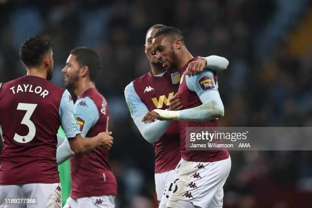 Jonathan Kodjia of Aston Villa celebrates after scoring a goal to make it 4-0 during the Carabao Cup Quarter Final match between Aston Villa and...