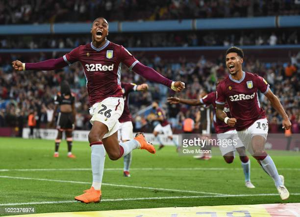 Jonathan Kodjia of Aston Villa celebrates after scoring his team's second goal during the Sky Bet Championship match between Aston Villa and...