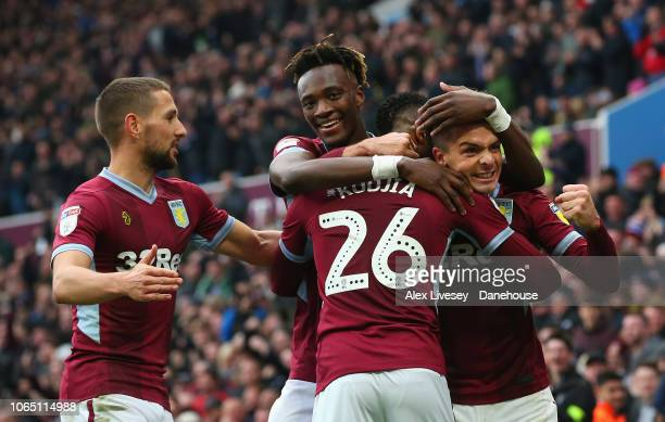 Jonathan Kodjia of Aston Villa celebrates with Jack Grealish and Tammy Abraham after scoring their first goal during the Sky Bet Championship match...