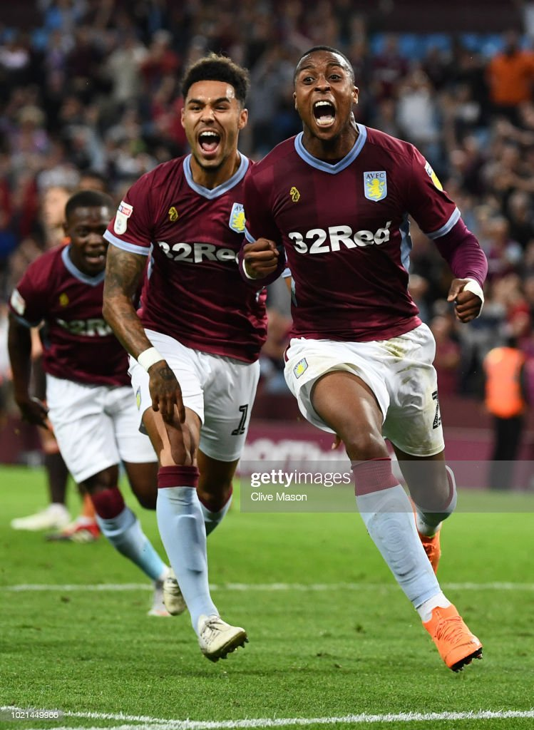 Jonathan Kodjia of Aston Villa celebrates with team mate Andre Green after scoring his team's second goal during the Sky Bet Championship match between Aston Villa and Brentford at Villa Park on August 22, 2018 in Birmingham, England.