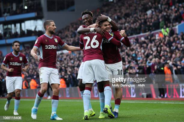 Jonathan Kodjia of Aston Villa celebrates with team mates after scoring a goal to make it 11 during the Sky Bet Championship match between Aston...