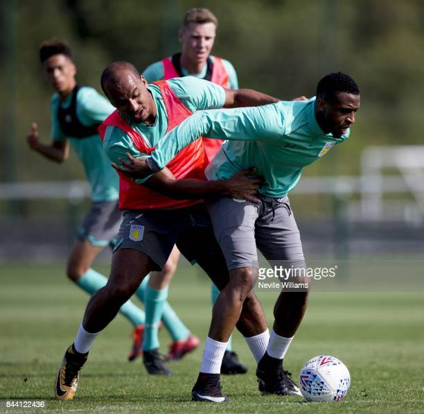 Jonathan Kodjia of Aston Villa in action with team mate Gabriel Agbonlahor during a training session at the club's training ground at Bodymoor Heath...