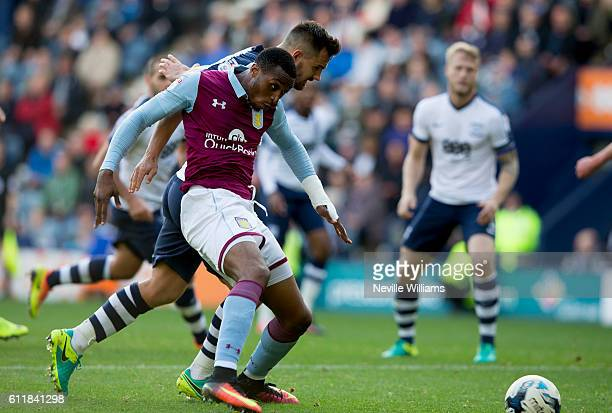 Jonathan Kodjia of Aston Villa is challenged by Bailey Wright of Preston North End during the Sky Bet Championship match between Preston North End...