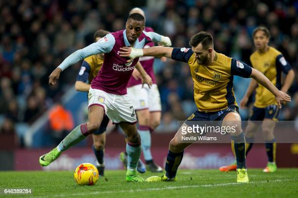 Jonathan Kodjia of Aston Villa is challenged by Bailey Wright of Bristol City during the Sky Bet Championship match between Aston Villa and Bristol...