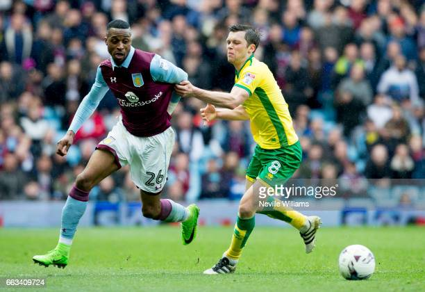 Jonathan Kodjia of Aston Villa is challenged by Jonny Howson of Norwich City during the Sky Bet Championship match between Aston Villa and Norwich...