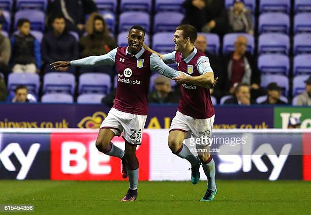 Jonathan Kodjia of Aston Villa is congratulated by team mate Gary Gardener after scoring the opening goal during the Sky Bet Championship match...