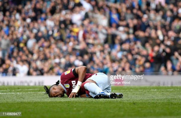 Jonathan Kodjia of Aston Villa on the floor injured during the Sky Bet Championship match between Leeds United and Aston Villa at Elland Road on...