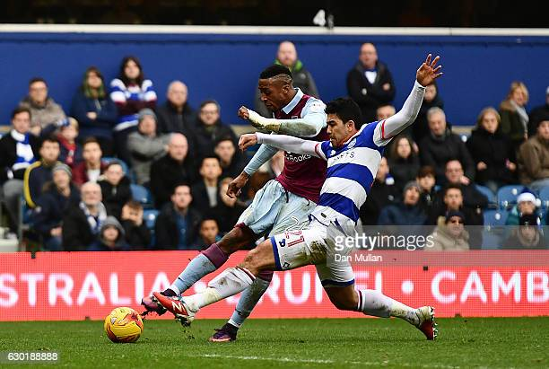 Jonathan Kodjia of Aston Villa scores his side's first goal during the Sky Bet Championship match between Queens Park Rangers and Aston Villa at...