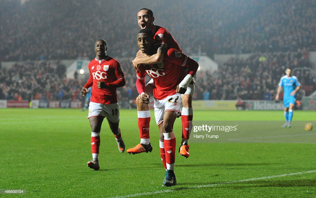 Jonathan Kodjia of Bristol City celebrates his sides goal with Derrick Williams of Bristol City on his shoulders during the Sky Bet Championship match between Bristol City and Wolverhampton Wanderers at Ashton Gate on November 3, 2015 in Bristol, England.