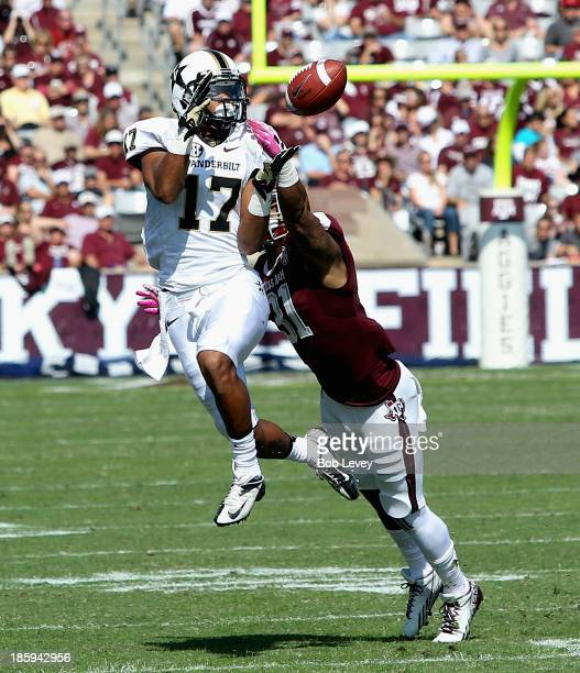 Jonathan Krause of the Vanderbilt Commodores completes a pass in front of Howard Matthews of the Texas A&M Aggies in the first quarter at Kyle Field...