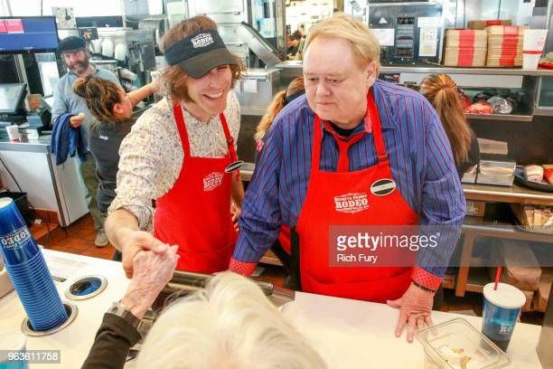 Jonathan Krisel and Louie Anderson serve customers during the FYC event for FX's 'Baskets' at Arby's on May 29 2018 in Los Angeles California