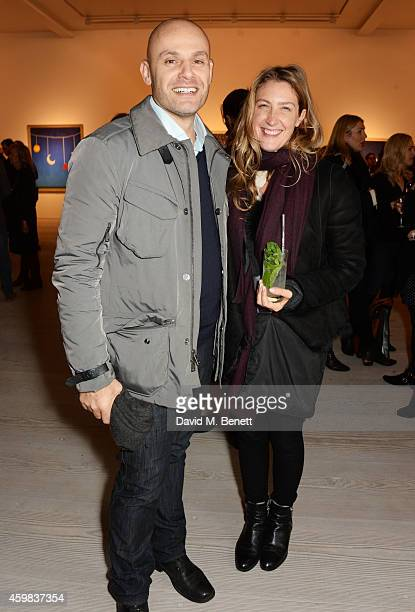 """Jonathan Kron and Georgina Cohen attend a private view of """"And The Stars Shine Down"""" by Stasha Palos at the Saatchi Gallery on December 2, 2014 in..."""