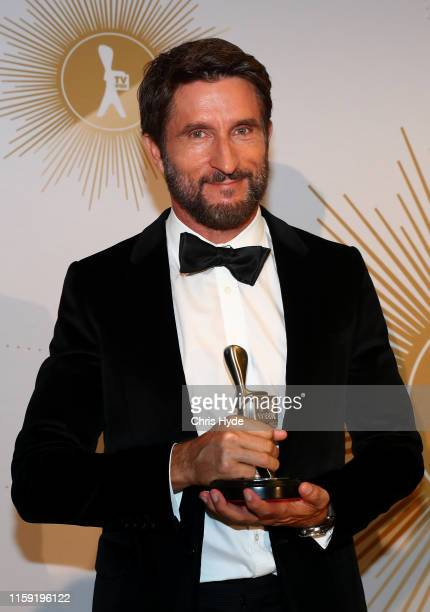 Jonathan LaPaglia poses with the Logie Award for Most Outstanding Reality Program for Australian Survivor during the 61st Annual TV WEEK Logie Awards...