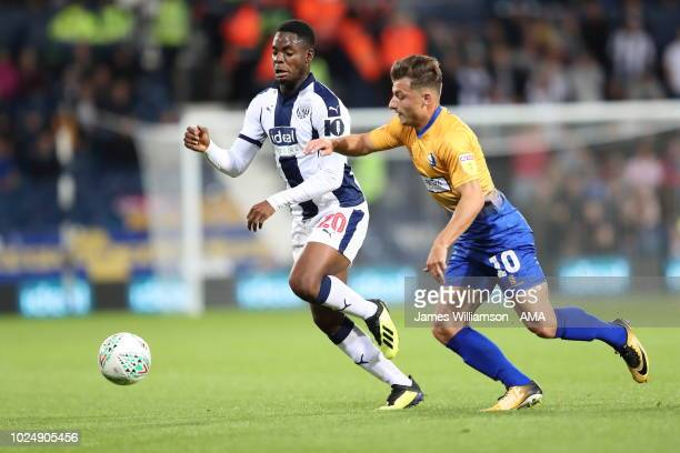 Jonathan Leko of West Bromwich Albion and Otis Khan of Mansfield Town during the Carabao Cup Second Round match between West Bromwich Albion and...