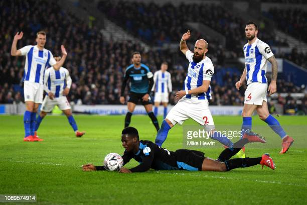 Jonathan Leko of West Bromwich Albion is challenged by Bruno Saltor Grau of Brighton and Hove Albion during the FA Cup Fourth Round match between...
