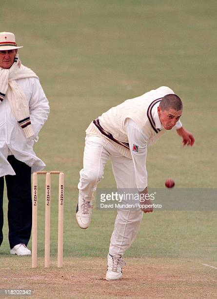 Jonathan Lewis bowling for Gloucestershire circa May 1997