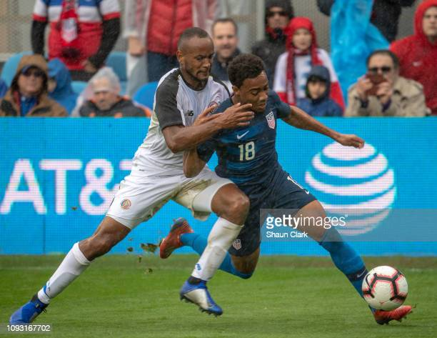 Jonathan Lewis of the United States goes past Pablo Arboine of Costa Rica during the international friendly match between the United States and Costa...