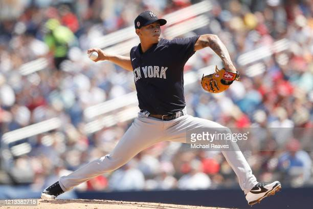 Jonathan Loaisiga of the New York Yankees in action against the Washington Nationals at FITTEAM Ballpark of The Palm Beaches on March 12 2020 in West...