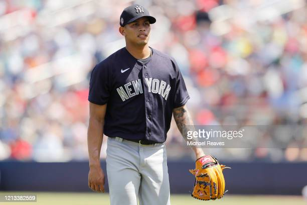 Jonathan Loaisiga of the New York Yankees looks on against the Washington Nationals at FITTEAM Ballpark of The Palm Beaches on March 12 2020 in West...