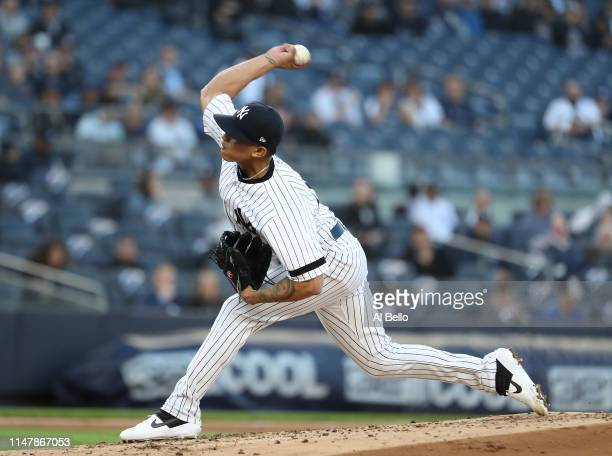 Jonathan Loaisiga of the New York Yankees pitches against the Seattle Mariners during their game at Yankee Stadium on May 08 2019 in New York City