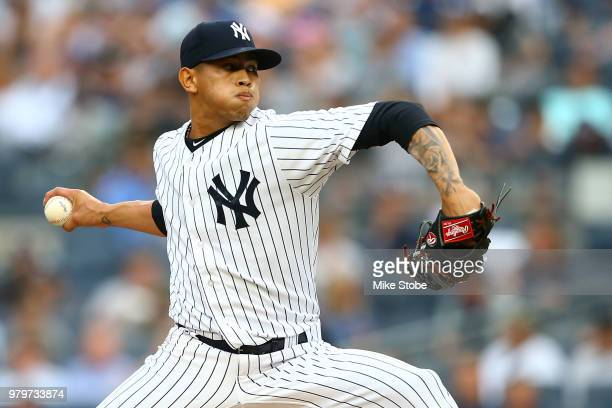 Jonathan Loaisiga of the New York Yankees pitches in the first inning against the Seattle Mariners at Yankee Stadium on June 20 2018 in the Bronx...