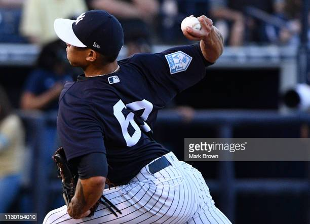 Jonathan Loaisiga of the New York Yankees pitches the ball in the first inning during the spring training game against the Baltimore Orioles at...