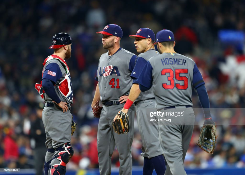 Jonathan Lucroy #25, Danny Duffy #41, Ian Kinsler #3 and Eric Hosmer #25 of Team USA talk on the mound during Game 6 of Pool F of the 2017 World Baseball Classic against Team Dominican Republic on Saturday, March 18, 2017 at Petco Park in San Diego, California.