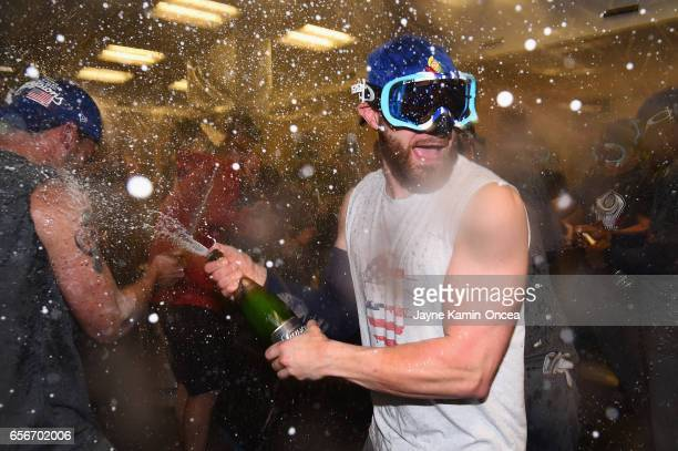 Jonathan Lucroy of team United States celebrates in the locker room after their 80 win over team Puerto Rico during Game 3 of the Championship Round...