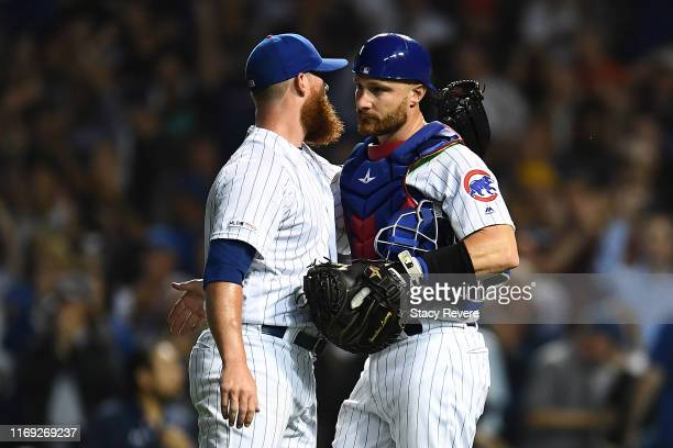 Jonathan Lucroy of the Chicago Cubs congratulates Craig Kimbrel following a victory over the San Francisco Giants at Wrigley Field on August 20 2019...