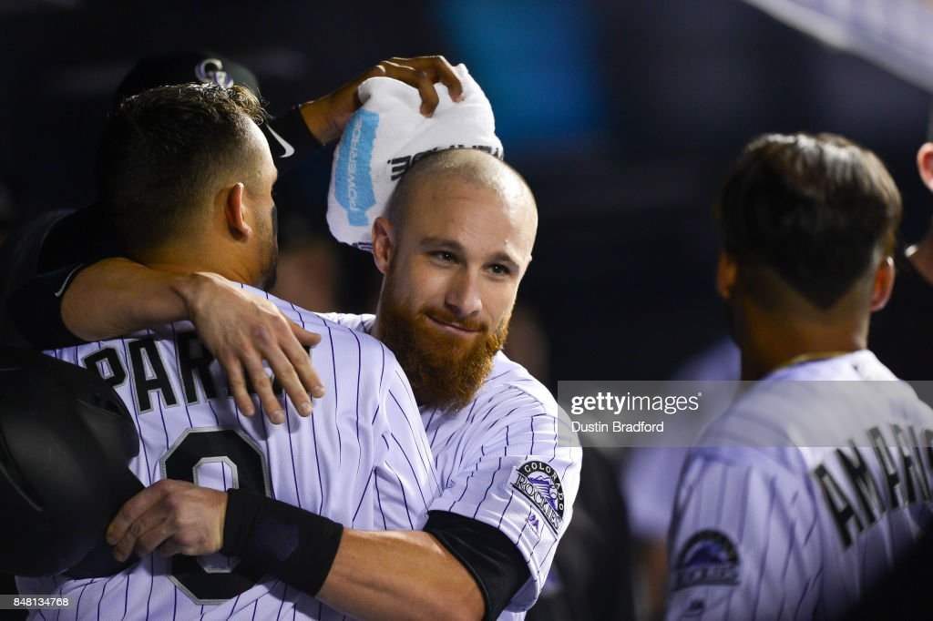 Jonathan Lucroy #21 of the Colorado Rockies celebrates with Gerardo Parra #8 after scoring a 6th inning run against the San Diego Padres at Coors Field on September 16, 2017 in Denver, Colorado.
