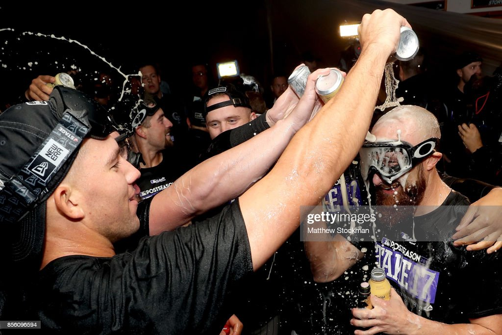 Jonathan Lucroy #21 of the Colorado Rockies is doused by his teammates in the lockerroom at Coors Field on September 30, 2017 in Denver, Colorado. Although losing 5-3 to the Los Angeles Dodgers, the Rockies celebrated clinching a wild card spot in the post season.