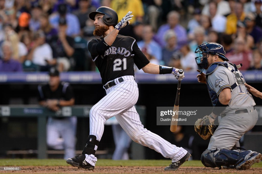 Jonathan Lucroy #21 of the Colorado Rockies watches the flight of a fourth inning RBI single against the Milwaukee Brewers at Coors Field on August 19, 2017 in Denver, Colorado.