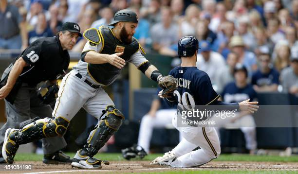 Jonathan Lucroy of the Milwaukee Brewers beats the tag from Russell Martin of the Pittsburgh Pirates at home plate putting thee Brewers up 42 in the...