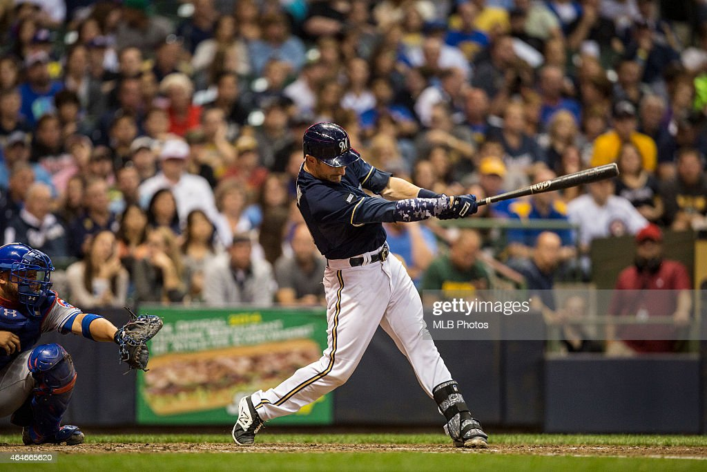 Jonathan Lucroy #20 of the Milwaukee Brewers breaks a Major League Baseball record by hitting his 46th double in a single season as a catcher during the game against the Chicago Cubs at Miller Park on Saturday, September 27, 2014 in Milwaukee, Wisconsin.