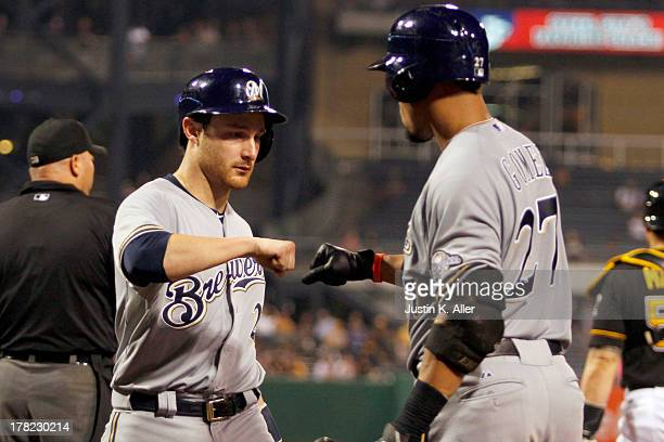 Jonathan Lucroy of the Milwaukee Brewers celebrates after scoring in the fifth inning against the Pittsburgh Pirates during the game on August 27...