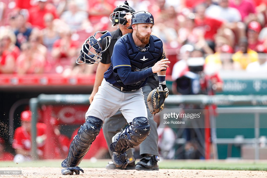 Jonathan Lucroy #20 of the Milwaukee Brewers chases a wild pitch that allowed Billy Hamilton of the Cincinnati Reds to score the winning run in the ninth inning at Great American Ball Park on July 17, 2016 in Cincinnati, Ohio. The Reds defeated the Brewers 1-0.