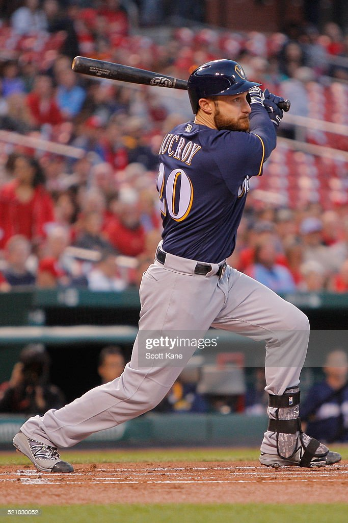 Jonathan Lucroy #20 of the Milwaukee Brewers follows through on a RBI single during the first inning of a baseball game against the St. Louis Cardinals at Busch Stadium on April 13, 2016 in St. Louis, Missouri.