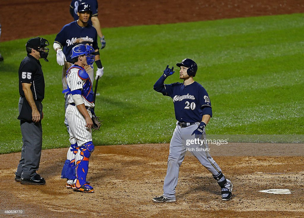 Jonathan Lucroy #20 of the Milwaukee Brewers gestures after hitting a two-run home run in the 13th inning against the New York Mets on June 12, 2014 at Citi Field in the Flushing neighborhood of the Queens borough of New York City.