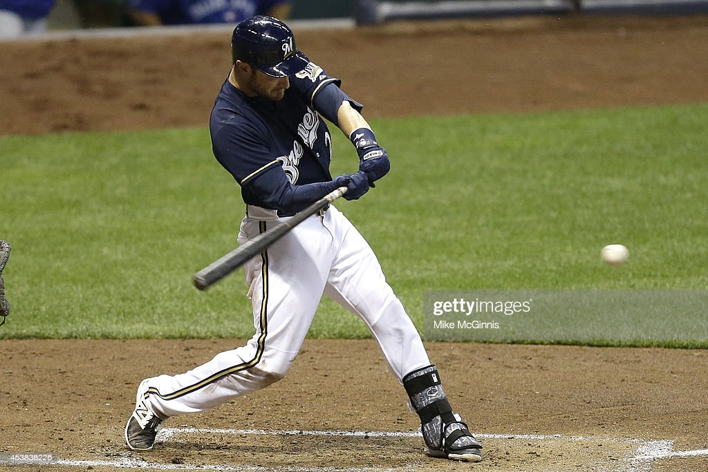 Jonathan Lucroy #20 of the Milwaukee Brewers hits a double in the bottom of the third inning against the Toronto Blue Jays during the Interleague game at Miller Park on August 19, 2014 in Milwaukee, Wisconsin.