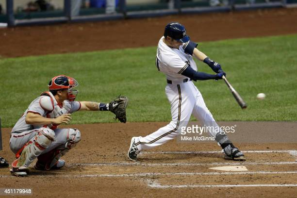 Jonathan Lucroy of the Milwaukee Brewers hits a single in the bottom of the fourth inning against the Washington Nationals at Miller Park on June 24...
