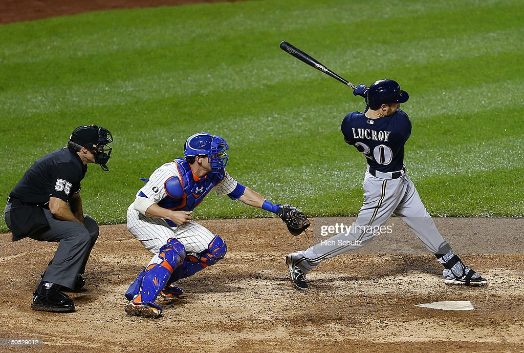 Jonathan Lucroy #20 of the Milwaukee Brewers hits a two-run home run in the 13th inning against the New York Mets on June 12, 2014 at Citi Field in the Flushing neighborhood of the Queens borough of New York City.