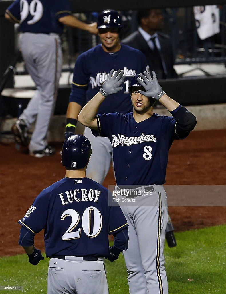 Jonathan Lucroy #20 of the Milwaukee Brewers is congratulated by teammates Ryan Braun #8 and Aramis Ramirez #16 after hitting a two-run home run in the 13th inning against the New York Mets on June 12, 2014 at Citi Field in the Flushing neighborhood of the Queens borough of New York City.