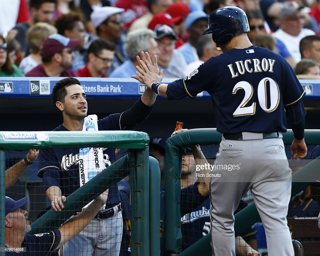 Jonathan Lucroy #20 of the Milwaukee Brewers is congratulated by teammate Ryan Braun #8 after scoring on a double by Adam Lind #24 against the Philadelphia Phillies during the first inning of a MLB game at Citizens Bank Park on June 29, 2015 in Philadelphia, Pennsylvania.