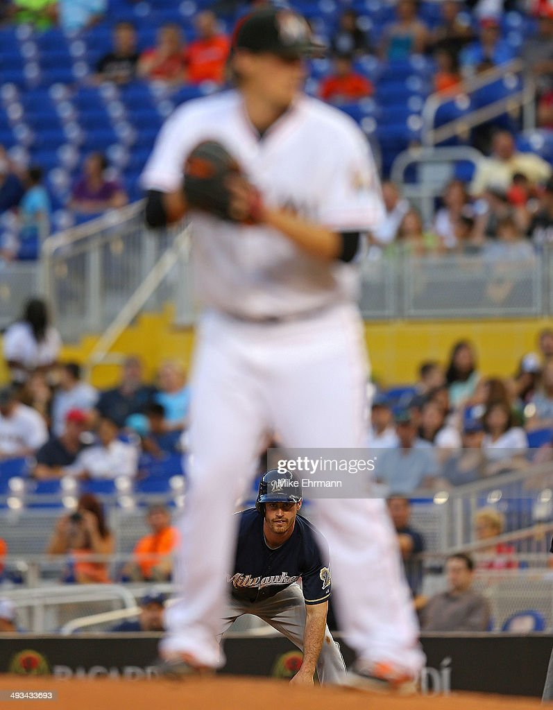 Jonathan Lucroy #20 of the Milwaukee Brewers looks on as Tom Koehler #34 of the Miami Marlins pitches during a game at Marlins Park on May 23, 2014 in Miami, Florida.